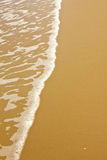 Shiny tropic sea wave on golden beach sand Stock Images