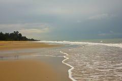 Shiny tropic sea wave on golden beach sand Royalty Free Stock Photos