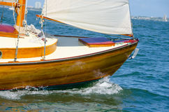 Shiny varnished wooden sailboat bow sailing Stock Image