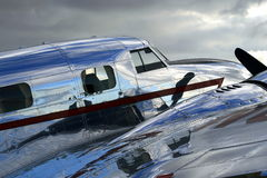 Shiny Vintage Aircraft. A polished, shiny fuselage at an airshow in late afternoon light Stock Images