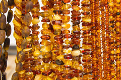 Shiny womanly amber necklaces on stall at the bazaar Royalty Free Stock Photo