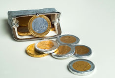 Shiny women`s coin purse with chocolate euro coins Stock Images