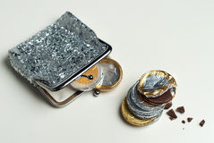 Shiny women`s coin purse with chocolate euro coins Royalty Free Stock Photography