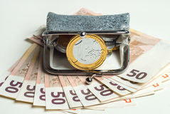 Shiny women`s coin purse with chocolate euro coins Royalty Free Stock Photo