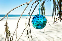 Shiny xmas ball at beach Stock Photos