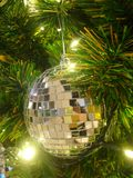 Shiny Xmas ball on gree pine tree. Sparkling Christmas decoration Royalty Free Stock Photos