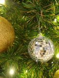 Shiny Xmas ball on gree pine tree. Sparkling Christmas decoration Stock Photography