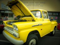 Shiny Yellow Chevy old pickup truck royalty free stock photography