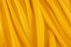 Shiny yellow fabric Royalty Free Stock Images