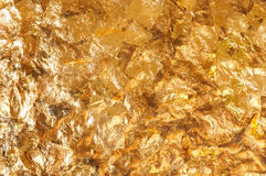 Shiny yellow gold leaf foil texture background Royalty Free Stock Photography