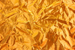 Shiny yellow leaf gold foil texture background Stock Photography