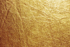 Shiny yellow leaf gold foil texture background.  Stock Image