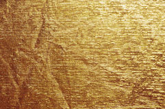 Shiny yellow leaf gold foil texture background.  Royalty Free Stock Images