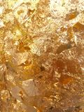 Shiny yellow leaf gold foil texture. Background pattern Stock Image