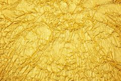 Shiny yellow leaf gold foil texture background stock images