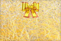 Shiny yellow leaf gold and  silver ribbon on Shiny foil texture Stock Photos