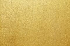 Shiny yellow leaf gold of wall texture background.  Royalty Free Stock Image