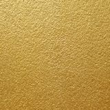 Shiny yellow leaf gold of wall texture background Royalty Free Stock Photography