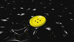 Shiny yellow plastic button over a lot of blacks. A group of plastic black clothe buttons with one shiny yellow over all of it Stock Image