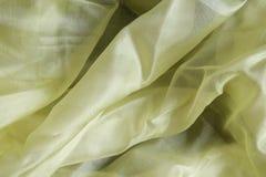 Shiny yellow silk handkerchief Stock Photos