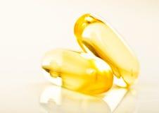 Shiny yellow vitamin e Stock Photos