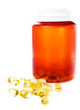 Shiny yellow vitamin E omega 3 fish oil capsules and pill bottle Stock Images