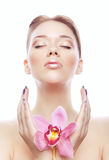 Shiny young woman with flower Royalty Free Stock Photo