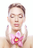 Shiny young woman with pink flower Stock Photos