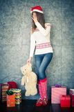 Shiny young woman with teddy bear Royalty Free Stock Photos