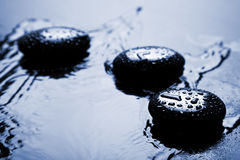 Shiny zen stones with water drops Stock Photos