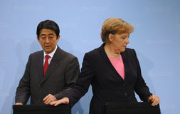 Shinzo Abe, Angela Merkel Stock Photography