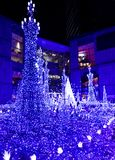 Shiodome Caretta Illumination 2018. Shiodome Caretta is a popular winter illumination event in Tokyo. For 2018, the main display features a light sequence synced stock image