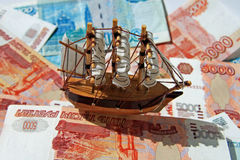 Ship in «the monetary sea». The children's ship on Russian money Stock Image