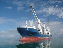 Ship. Big cargo ship anchored in the ocean waiting for delivery Stock Images