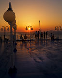 Sunset on the ship with people silhouetts. On the ship at sunset hour, travelling to a Greek island at summer time stock photos