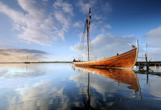Ship. Viking ships at sunrise when the sun lights up the ship from side Royalty Free Stock Photo