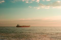 Ship. Big oil ship leaving the harbour, early morning stock photography