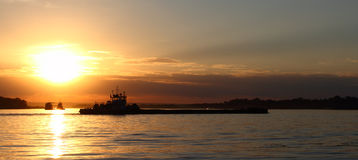 Ship. The river craft against the sunset sun Stock Image