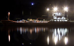 Ship. Boat in a port at night with reflections Royalty Free Stock Photos