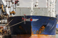 Ship. Workers in business for maintenance of a cargo ship in port Royalty Free Stock Image