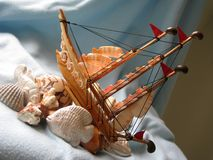 Ship. A handy craft ship made by variety shell Royalty Free Stock Photography