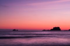 Ship across the ocean at Sunset, in Tofino beach, Canada. Ship across the ocean at Sunset, in Tofino beach, Vancouver Island, Canada Stock Image