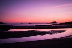 Ship across the ocean at Sunset, in Tofino beach. Vancouver Island, Canada Royalty Free Stock Photos