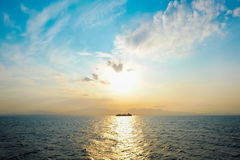 Ship on the Aegean sea with fantasy sky and dramatic sunrise in the morning Stock Image