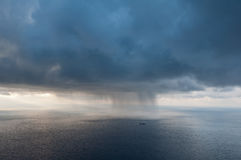 The ship against the storm. A dense cloud, it approaches the coast, dumping hail Stock Image