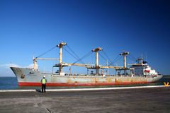 Ship agent. Chinese cargo ship in final approach to dock, with ship agent supervising the maneuver Royalty Free Stock Photo