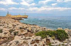 Ship aground near rocky coast Royalty Free Stock Photo