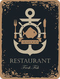 Ship anchor and seafood. Banner with ship anchor and seafood restaurant with fish, helm and cutlery Royalty Free Stock Image