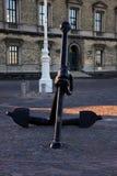Ship Anchor. A ship anchor statue lays on a cobblestone floor in the city of Copenhagen Stock Photos