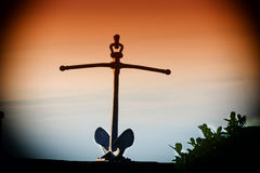 Ship anchor on a wall. Old rusty ship anchor on a wall royalty free stock photography